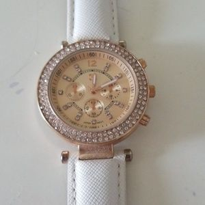 rose gold and white faux leather watch